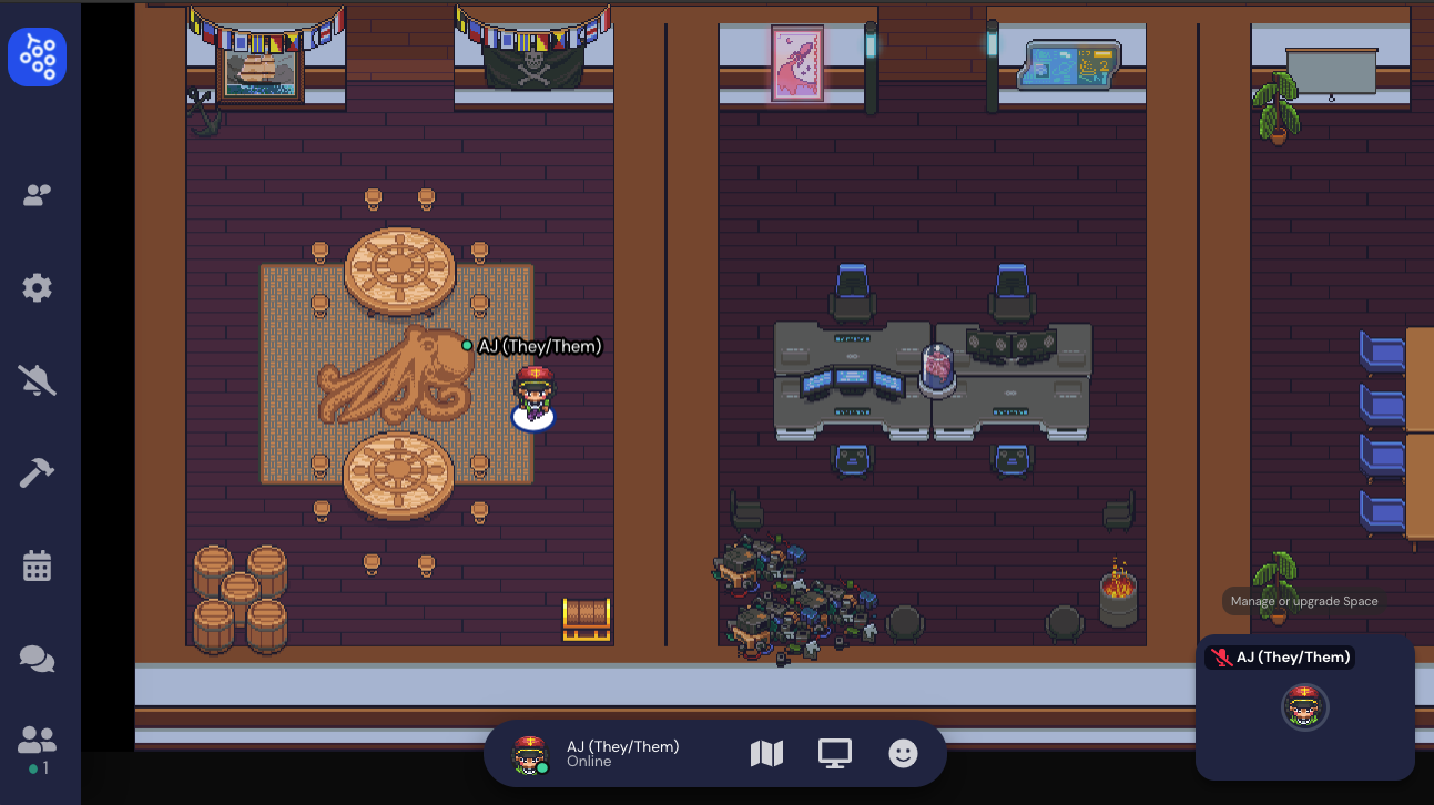 A screenshot of the office complex, focused on the two conference rooms in the bottom left of the map. A character named AJ (They/Them) is standing alone in a nautical-themed room, which has two circular tables, several barrels, a treasure chest, a ship painting, a pirate flag, and bunting. In the cyberpunk themed conference room to the right, four grey desks are grouped together, with a brain in a jar resting on top. Piles of waste and a trash barrel fire are in the room, as well as a neon image of a rocket and a digital map on the wall.